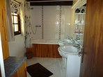 bathroom with bath & overbath shower plus twin sinks basins