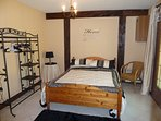 bedroom with double bed and access to bathroom