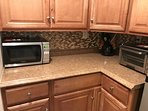Kitchenette with variety of counter top appliances, cooking, dinning supplies