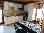 full kitchen with dinning table and everything you need