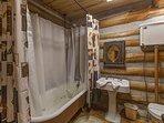Main bathroom with bear claw tub/shower