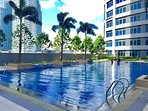 Swimming pool area made more beautiful with ample trees and landscapes