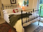 Cosy Victorian iron bed with White Company linen and 13.5 tog feather duvet.