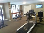 Fitness facility overlooking indoor pool area . . .