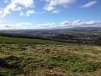 Balmashanner Hill looks over Forfar and the Strathmore Valley to the Grampian Mountains beyond.