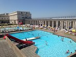 outdoor city swimming pool at 50 m in june-july-aug-sept