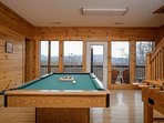 Have fun in the play room  with pool table/ foosball and lots of board game while enjoying the view
