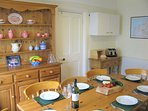 Dining room, comfortably seats 8 with direct access to kitchen.