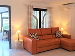 Good sized lounge with Italian leather sofa bed.