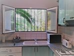 Large separate kitchen with washing machine, microwave, gas hob and electric oven. Fully equipped.