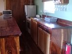 Fully furnished kitchen microwave, gas stove/oven, refer/freezer, pots, pans, dishes, utensils, etc.