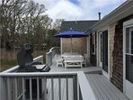 Large deck with BBQ grill and dining area