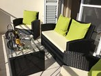Front Balcony with comfortable furniture - sitback and enjoy the view with a nice cold beer