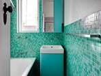 Aqua mosaic tiled bathroom.