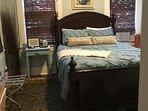 Bedroom w/queen size comfortable bed.