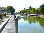 Canal right off the outdoor patio. Complete with jumping fish and an occasional dolphin!