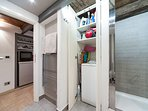 the washing-dryer machine, iron and ironing board and detergents are hidden by a closet