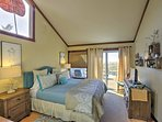 You'll enjoy great nights of sleep in the master bedroom, equipped with a king-sized bed and stunning views of the...