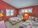 The spacious second bedroom features 2 queen beds.