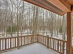 Enjoy forested views from the private balcony.
