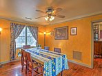 Gather for dinner at this dining table surrounded by yellow walls.