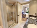 Glass shower, soaking tub, and double vanity in second bathroom
