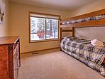 These twin-over-twin bunk beds and twin-sized trundle bed is perfect for the kids.