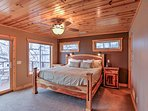 The master bedroom features a king-sized bed and access to the spacious deck.