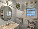 Freshening up in this pristine bathroom will be a pleasure, not a chore.