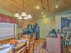 The dining area opens up into the fully equipped kitchen.