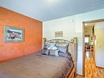 Head to this bedroom with a queen bed when eyes grow tired.