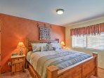 Watch your favorite shows on the flat screen cable TV before falling into a deep sleep in  this plush king-sized bed.