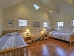 The 4th bedroom has 2 twin beds.