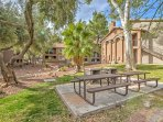 This complex has picnic table seating and tall trees to enjoy as you walk around.