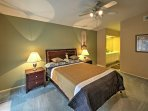 After boisterous days at Disneyland or exploring Corona, rest on the plush master bedroom's queen mattress.