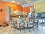 The kitchen bar seating is perfect for sipping your morning coffee and watching the news.
