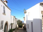 Typical cobbled street with white washed houses in Castelo de Vide.