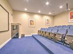 Watch movies in the community movie theater.
