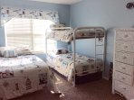 Kids room with twin bunks and full sized bed