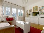 Living room with double sofa bed, smart TV and exit to the sunny terrace.