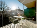 Sunny terrace next to the living room, with table and chairs for 4 persons.