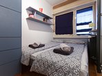 Bedroom with double bed and big closet.