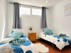 A cool twin bedroom