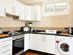 washing machine, oven, microwave, kettle, toaster