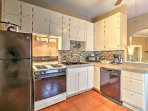 The fully-equipped kitchen comes complete with all the necessary cooking appliances.