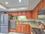 The kitchen offers new appliances and ample counter space.