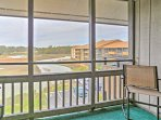 Spectacular views of the marshlands behind the condo make this balcony a pleasant place to hangout with your travel...