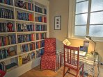 Work from home in this office nook with built-in library book case!