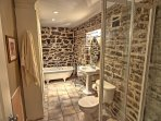 Draw yourself a bath in the newly renovated bathroom with exposed stone walls.