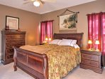 The master bedroom features a plush queen-sized bed.